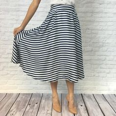 "Blue & White Striped Midi Skirt - Low Inventory! Satiny midi skirt in dark blue and white striped pattern. Pleats at waist for feminine flair. Pockets at hips. Hidden back zip closure. Partially lined. Brand new.   Waist measurement: S = 13.5"" M = 14"" L = 14.5""  Please carefully review each photo before purchase as they are the best descriptors of the item. My price is firm. No trades. First come, first served. Thank you! :) Relished Skirts Midi"