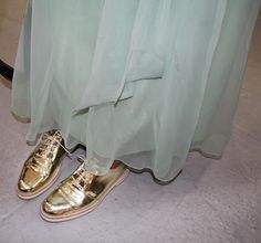 Skirt with gold shoes
