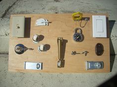 Locks and latches board for a toddler using upcycled stuff from the garage