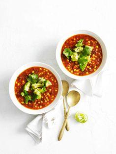 corn/tomato soup with avocado & lime