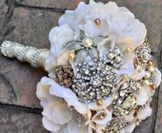 I'm not a fan of diamonds, but the rhinestones look wonderful with the pearls (dark and light) and mixed metals here!