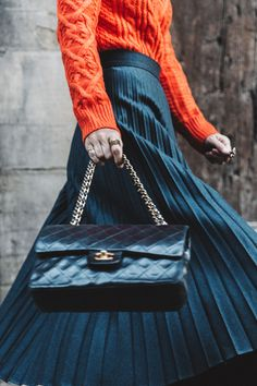 Chanel bag, cable knit and a maxi pleated skirt