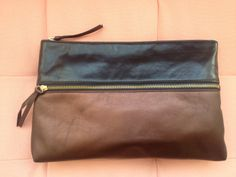 Zelta Large Clutch in Bronze and Black shot at Olive & June Los Angeles- outer zipper small pocket