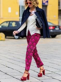 White top, navy jacket, pink print pants and red platform sandals.
