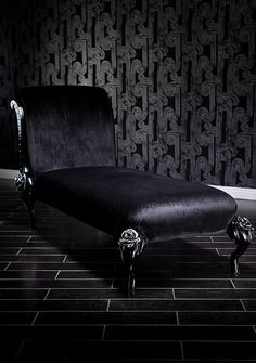 4133 BLACK BAROQUE CHAISE LOUNGE WITH ROSES AND SILVER ACCENTS  Lay back and relax peacefully on this incredibly romantic black-on-black chaise. The curled backrest and the beautiful roses on the legs are ornately hand-carved to make this incredible design. It is then upholstered in sumptuous velvet, and the frame is painted in a fabulous black and red finish, making it perfectly gorgeous and extremely comfortable.  31 x 37 x 39 IN