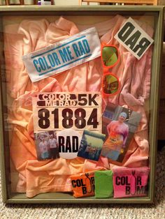 Shadow box from my 1st 5k. Color Me Rad. With t-shirt (preserved using the vinegar & heat method), race bib, swag, & I saved my color bombs.