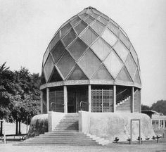Bruno Taut's Glashaus built for the Deutscher Werkbund exhibition of 1914. The concrete and glass pavilion - with its coloured prismatic roof and glass brick walls – demonstrated the full range of vitreous architectural applications afforded by science.    The Cologne exhibition also featured notable works by Walter Gropius and Adolf Meyer (a model factory) and a prototype theatre by Henry van de Velde.    [Photo by unknown photographer - source Wikimedia Commons - public domain because of…