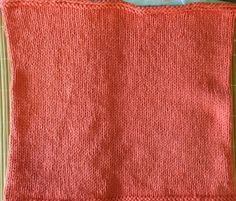 Hand knitted scarf in coral colored cotton