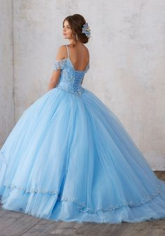 Quinceañera Ballgown Combines an Intricately Beaded Bodice Featuring Off-the-Shoulder Cap Sleeves, with a Split Front Tulle Skirt. Matching Stole. Corset Back.