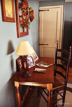 Colonial Decor. Antique drop leaf table used as a writing desk. Painted ladder back chair in black milk paint distressed for a vintage look.