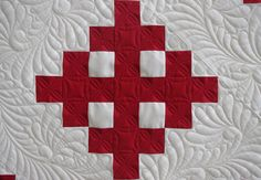 Red Cross Quilt by QOB, via Flickr--love this feather design