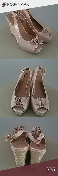 CANDIE'S NUDE OPEN TOE RUFFLE DETAIL WEDGES SZ 7.5 CANDIE'S SUPER CUTE PEEP TOE NUDE WEDGES WITH A RUFFLE DETAIL. MAKE YOUR LEGS LOOK LONGER WITH THESE ELEGANT SHOES. SIZE 7.5 Candie's Shoes Wedges