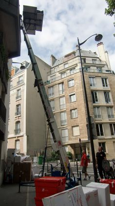 Moving day in Paris - look at the picture closely. That's a couch on top of there! Now look at the windows/doors in the surrounding buildings and think how in the world will it fit! Remember Navy members - if you have OCONUS orders and oversize furniture, make sure to use that NTS entitlement (if you have one).