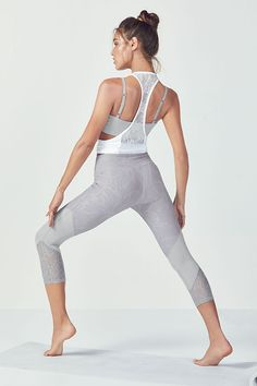 Dial in the details in our lace-back, lightweight tank, crossover bra and lace-paneled compression capris.