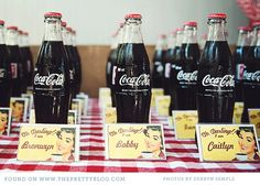 I don't know about name tags but the old school coke bottles are adorable!