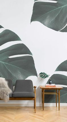 The design of our Photographic Monstera Wall Mural is simple yet will make a bold statement in your interior. Invite the calming effect of nature into your living room to create a relaxing atmosphere. The close-up, highly filtered photography of the faux plant creates an interesting, minimalist style for this larger than life botanical mural. #wallpaper #mural #wallmural #livingroom