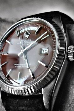 I don't even like Rolex, but this on isn't bad. Ox-blood dialed white gold vintage Rolex Day-Date Presidential (ref: on a great suede strap. Vintage Rolex, Vintage Watches, Vintage Men, Fine Watches, Cool Watches, Watches For Men, Luxury Watches, Rolex Watches, Der Gentleman