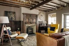 This run-down cottage in South Yorkshire was lovingly renovated on a shoestring budget. The homeowner carefully restored the wood panelling in the sitting room before putting her stamp on the house with an eclectic and modern design scheme beautifully merging old with new. Take a tour via the link in bio. . Photo: Jeremy Phillips . #homebuilding #renovation #cottage #cottagelife #yorkshire #yorkshirecottage #traditional #history #contemporary #interiordesign #livingroom #idea #home #interiors #k