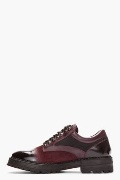 "MCQ ALEXANDER MCQUEEN //  Oxblood Brushed Suede Polished Toe Shoes  32114M002001  Low top brushed suede shoes in oxblood. Round toe. Black lace up closure with black lace hooks. Leather trimmings throughout in oxblood. Polished toe and heel in black. Contrast textile panel in black. Padded collar. Vibram rubber lug sole in black. Tone on tone stitching. Approx 1.5"" heel. Leather/textile upper, Vibram rubber sole. Made in Italy.  $865 CAD"