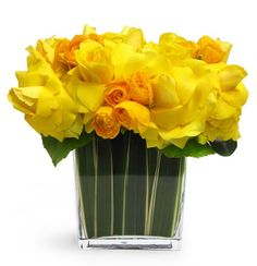 Arrangement of reflexed yellow roses and ranunculus so you can see what they look like in multiples.