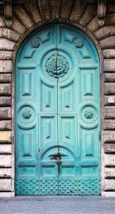 Door - Arched teal door.