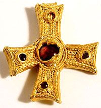 That is a pure gold 7th c. cross of Anglo-Saxon manufacture and it was found in a muddy field by yet another British dude with a metal detector.  I really need to invest in a metal detector and an airplane ticket to England...