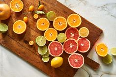 Oranges, grapefruit, lemons and limes citrus on wooden cutting board from above. Health & Wellness gallery by Trent Lanz for Stocksy United - Royalty-Free Stock Photos. berries, breakfast, bright, citrus, colorful, cut, daylight, delicious, diet, different, exotic, food, fresh, from above, fruit, green, half, health, healthy, horizontal, indoors, kitchen, knife, lemon, lime, marble, meal, nobody, nutrition, orange, organic, produce, sliced, succulent, table, variety, various, vitamin