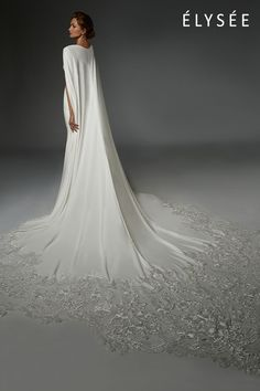 This strikingly beautiful gown blends modernist simplicity with traditional style. Bridal Dresses, Wedding Gowns, Cape Dress, Yes To The Dress, Stretch Lace, Embroidered Lace, Ciel, Beautiful Gowns, One Shoulder Wedding Dress