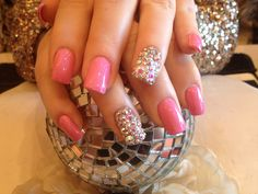 short acrylic nail designs | Acrylic nails with pink polish and Swarovski crystals on ring finger ...