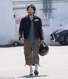 Dressed down: Keanu Reeves was spotted in LA on Wednesday wearing baggy cargo-style croppe...