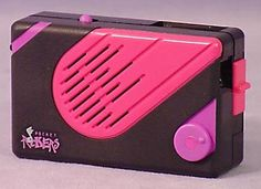 Pocket Rockers! I still have this (same color)! I have Huey Lewis, Tiffany, Debbie Gibson, Bon Jovi, & New Kids on the Block. I had ALL the little accesories too!