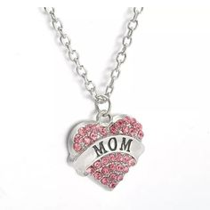 "MOM Pink Crystal Heart Necklace Perfect for a new mom, Mother's Day, birthday, or any day you choose. Pink crystals surround a silver plated heart. Pendant is approximately 1.1"" Long. Total length of chain and pendant is approximately 12.75"" Long. Please ask if you have questions. None Jewelry Necklaces"