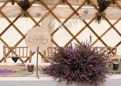 Yorkshire Yurt 2, Top table heather centre piece. Table names were different typefaces (Groom was a graphic designer), top table was the named after the typeface used on the wedding invitations  -  Photo by Ruth Mitchell Photography