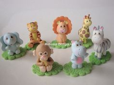 Maybe I can just get these porcelain cake toppers.. that way I don't have to mold animals.. AND I have a keepsake :)