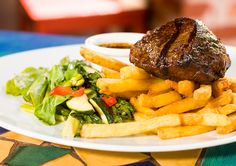 We are true masters of steaks! Here is an Angus Filet Mignon served with herbal butter, home-made chips and seasonal vegetables