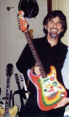 """George Harrison with """"Rocky"""". I met the man that made this guitar not long ago. Ringo Starr, George Harrison, John Lennon, Beatles Love, Les Beatles, Beatles Bible, Beatles Photos, Liverpool, Paulo Freire"""