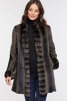 Our reversible coat indulges you in the sublime texture and beauty of Rex Rabbit fur. And whether you wear the fur side out or in, the fur collar, cuffs, and tuxedo complete the elegant design. Treasure this exceptional coat for every occasion. Spanish Rex rabbit fur coat reverses to polyester fabric.