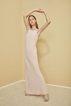The long, lean lines of the Calvin Klein blush crepe gown is perfect for a night out.
