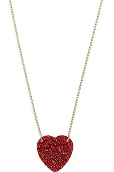 Bring out your inner Dorothy with this red glitter heart shaped necklace. The ruby red glitter is rich and sparkly, like all your dreams come true. It's Tatty Devine's own classic rounded heart, hung from a golden chain. A standout piece of sparkliness. Glitter Hearts, Red Glitter, Devine Love, Red And White Outfits, Heart Shaped Necklace, Tatty Devine, Jewelry Necklaces, Jewellery, Heart Shapes