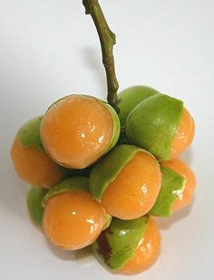 want to try all fruits, at least once-this one is Spanish lime, genip, guinep, genipe, ginepa, quenepa, chenet, canepa, mamon, limoncillo or mamoncillo per wikipedia.