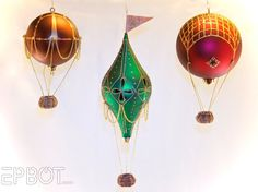 Hot Air Balloon Ornaments -- Made using plastic ornaments so that you can drill into them.  I can't help wondering if there's any way you could do something similar with glass ornaments. #painted