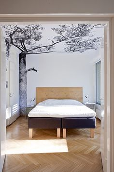 I love the idea of a natural landscape superimposed in ultra clean design. I had grand plans to paint gold bamboo on my green bedroom walls. This is infinitely more elegant. And doesn't involve the ACTUAL outdoors.
