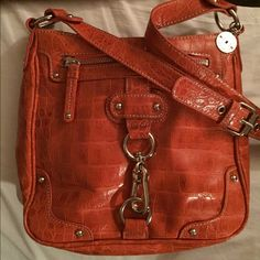 NWOT NINE WEST CROSSBODY  Gorgeous Deep Orange Nine West purse... Sz is 9x6 and pockets on front & back, 2-open pockets and one zipped inside.. Lots of room ( was a Christmas gift that's to small for me ) Nine West Bags Crossbody Bags