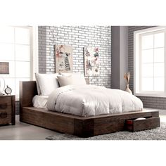 A modern structure that offers both visual appeal and storage capability in any bedroom, this low profile bed is a must-have. Wood construction and a natural toned finish add to the rustic visual, enhancing the cozy appeal.