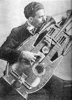 """Ancestor of the Double neck guitar which has existed at least 2 centuries (not to be confused with their first incarnation as """"harp"""" guitars). Manufacturers flirted with multi-neck designs during the swing era of the 1930s and 1940s, particularly for steel guitars. However, Gibson is credited with popularizing the first widely used double neck model, the EDS-1275, in 1958.  Info from ehow.com"""