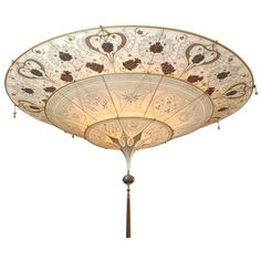 View this item and discover similar for sale at - Silk 3 Tiere Floral Fortuny Light Fixture. Shaped as an inverted pagoda and suspended by a delicate net of cords decorated with Murano glass beads. Chandeliers, Chandelier Pendant Lights, Modern Chandelier, Fortuny Lamp, Murano Glass Beads, Farmhouse Lighting, Light Shades, Candlesticks, Light Fixtures