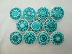 "Set of 10 aqua blue mandala print wood knobs are 1.5"" wide and have been painted…"
