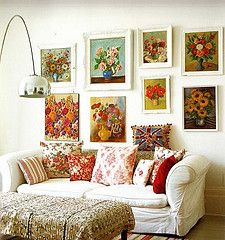 antique flower paintings on white wall: girly bliss...