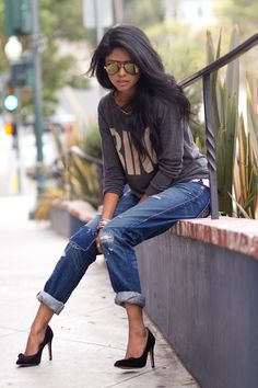 In my closet: tiger sweater, boyfriend jeans, black pumps