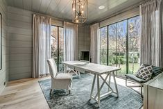 Designed by Muskoka Living Interiors in 2017, this home exudes style around every corner.  The main floor office was designed with a soft colour pallet and panelled walls giving off a very tranquil feel. | 45 First Street, Oakville
